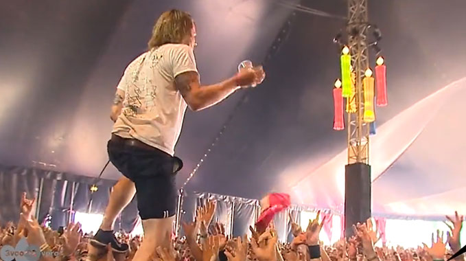 Photo of John Coffey singer catches beer while crowdwalking, and drinks it!