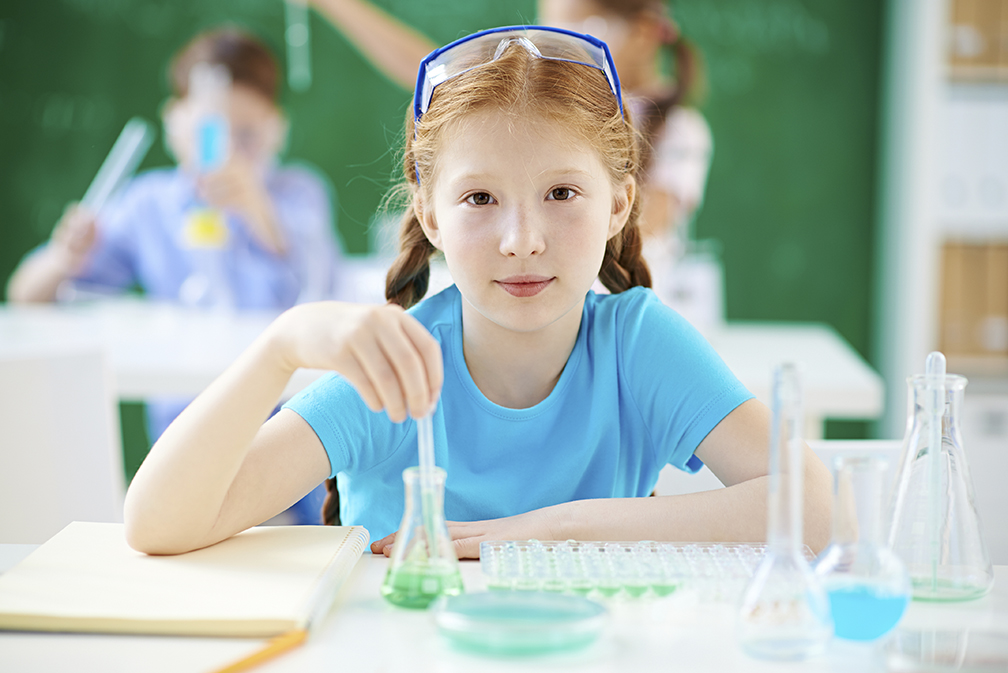 Photo of Elementary school students work on new drugs to treat cancer
