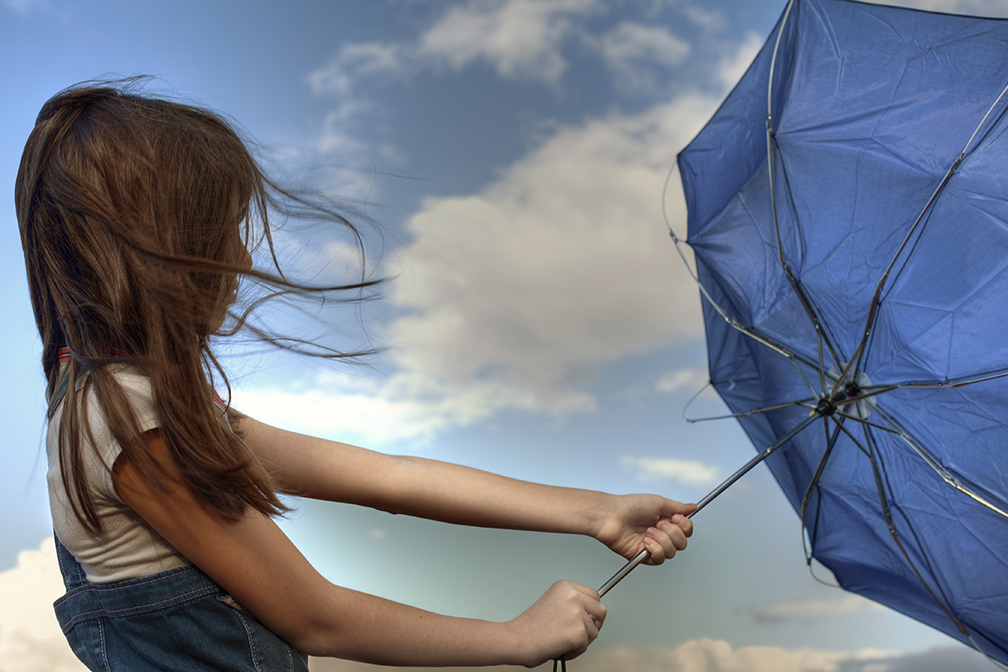 Photo of Beautiful girl is playing with umbrella in today's nice weather